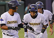 May 19, 2017 - Trenton, New Jersey, U.S - GLEYBER TORRES (center), an infielder for the Trenton Thunder, is congratulated by teammates after crossing home plate following his third-inning grand slam versus the Portland Sea Dogs at ARM & HAMMER Park. (Credit Image: © Staton Rabin via ZUMA Wire)