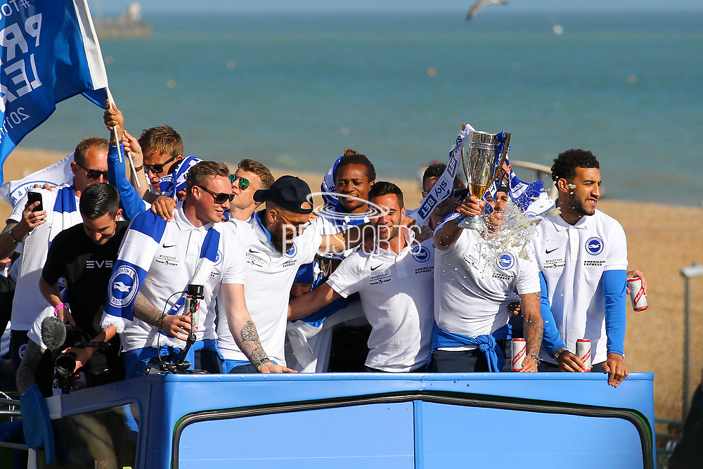 Brighton players celebrate on the open top bus during the Brighton & Hove Albion Football Club Promotion Parade at Brighton Seafront, Brighton, East Sussex. United Kingdom on 14 May 2017. Photo by Ellie Hoad.