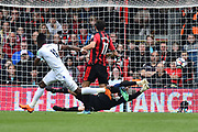 Wilfried Zaha (11) of Crystal Palace shoots at goal and Asmir Begovic (27) of AFC Bournemouth makes the save during the Premier League match between Bournemouth and Crystal Palace at the Vitality Stadium, Bournemouth, England on 7 April 2018. Picture by Graham Hunt.