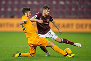 Declan Gallagher (#31) of Livingston FC tackles Benjamin Garuccio (#17) of Heart of Midlothian during the 4th round of the William Hill Scottish Cup match between Heart of Midlothian and Livingston at Tynecastle Stadium, Edinburgh, Scotland on 20 January 2019.