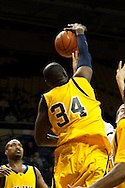 26 January 2010:  Kent State's Justin Greene (34) blocks a shot during the NCAA basketball game between Kent State and the Toledo Rockets at Savage Arena in Toledo, OH.