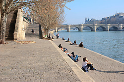 People relaxing on the river bank