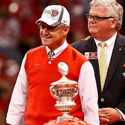 January 4, 2011; New Orleans, LA, USA; Ohio State Buckeyes head coach Jim Tressel stands by the Sugar Bowl Classic championship trophy following a win over the Arkansas Razorbacks in the 2011 Sugar Bowl at the Louisiana Superdome.Ohio State defeated Arkansas 31-26. Mandatory Credit: Derick E. Hingle
