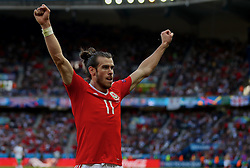 PARIS, FRANCE - Saturday, June 25, 2016: Wales' Gareth Bale celebrates setting up the first goal against Northern Ireland, an own goal, during the Round of 16 UEFA Euro 2016 Championship match at the Parc des Princes. (Pic by David Rawcliffe/Propaganda)