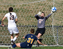 Virginia Cavaliers goalkeeper Celeste Miles (0) makes a save off of shot by West Virginia Mountaineers midfielder Carolyn Blank (31).  The #16 ranked Virginia Cavaliers defeated the #12 ranked West Virginia Mountaineers 3-2 in the second round of NCAA Division 1 Women's Soccer Tournament at Klockner Stadium on the Grounds of the University of Virginia in Charlottesville, VA on November 16, 2008.