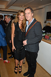 JEMIMA KHAN and ANGUS DEAYTON at a private view of photographs by Jolyon Fenwick 'The Zero Hours Panoramas' 100 Years On: Views From The Parapet of The Somme held at Sladmore Contemporary, 32 Bruton Place, London on 30th June 2016.