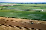 Nederland, Drenthe, Gemeente Borger-Odoorn, 05-08-2014; Tweede Exloermond, Zuider Boerplaatsen. Graanoogst in de veenkolonien. De combine maait het graan en dorst dit direct, het zgn. maaidorsen. Naast de maaidorser een kipper voor de afvoer van het graan. <br /> Grain harvest in a peat landscape, East Netherlands (near German border). The combine reaps the grain and threases it. Next to the combine harvester a dumper for the discharge of the grain. <br /> luchtfoto (toeslag op standard tarieven);<br /> aerial photo (additional fee required);<br /> copyright foto/photo Siebe Swart