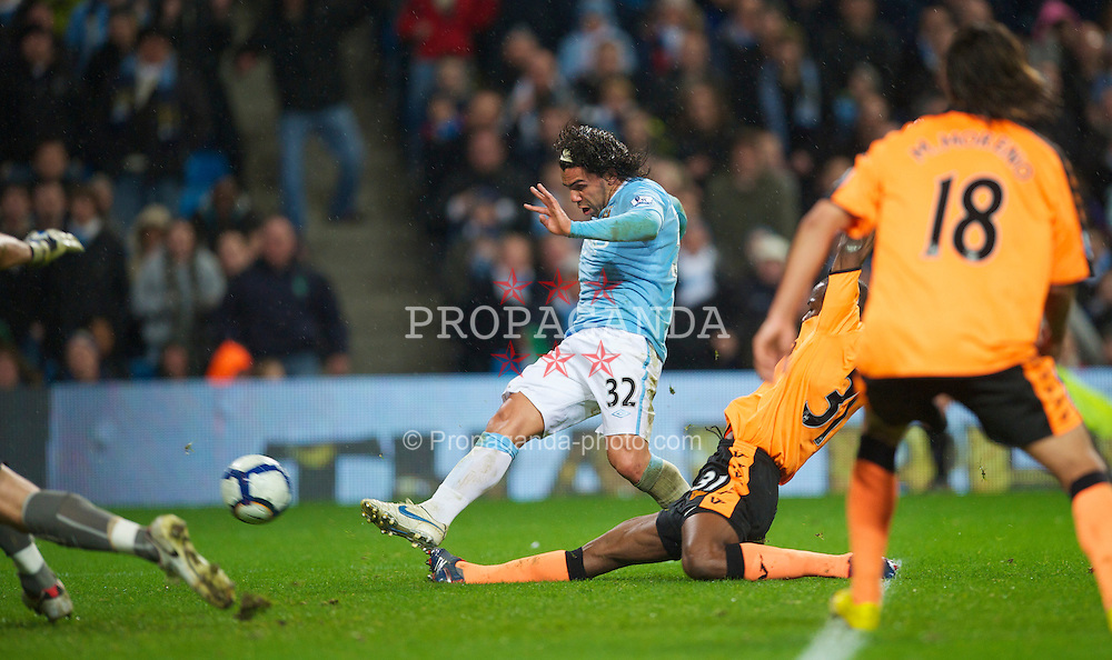 WIGAN, ENGLAND - Monday, March 29, 2010: Manchester City's Carlos Tevez scores the second goal of his hat-trick against Wigan Athletic during the Premiership match at the City of Manchester Stadium. (Photo by David Rawcliffe/Propaganda)