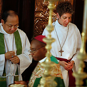 Presiding Bishop Katharine Jefferts Schori of the American Episcopal Church and the first woman elected primate in the Anglican Communion, takes communion at the Anglican cathedra. Leaders of the world's 77 million Anglicans, in Tanzania for a closed, six-day conference, traveled by boat from the mainland to celebrate the Eucharist in the only Anglican cathedral on this predominantly Muslim archipelago on the Indian Ocean.....