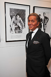 VALENTINO GARAVANI at a private view of photographs by Marina Cicogna from her book Scritti e Scatti held at the Little Black Gallery, 3A Park Walk London SW10 on 16th October 2009.