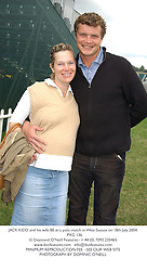 JACK KIDD and his wife BE at a polo match in West Sussex on 18th July 2004.<br /> PXG 136