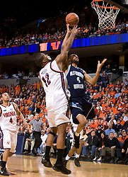 Virginia forward Jamil Tucker (12) blocks a shot by Old Dominion guard Brandon Johnson (4).  The Virginia Cavaliers men's basketball team defeated the Old Dominion Monarchs 80-76 in the second round of the College Basketball Invitational (CBI) at the University of Virginia's John Paul Jones Arena in Charlottesville, VA on March 24, 2008.