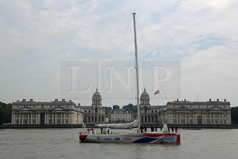 © Licensed to London News Pictures. 23/08/2013. GB team's Clipper Race vessel passing the Old Royal Naval College in Greenwich en route to St Catherine's Dock in preparation for the start of the round the world Clipper Race credit : Rob Powell/LNP
