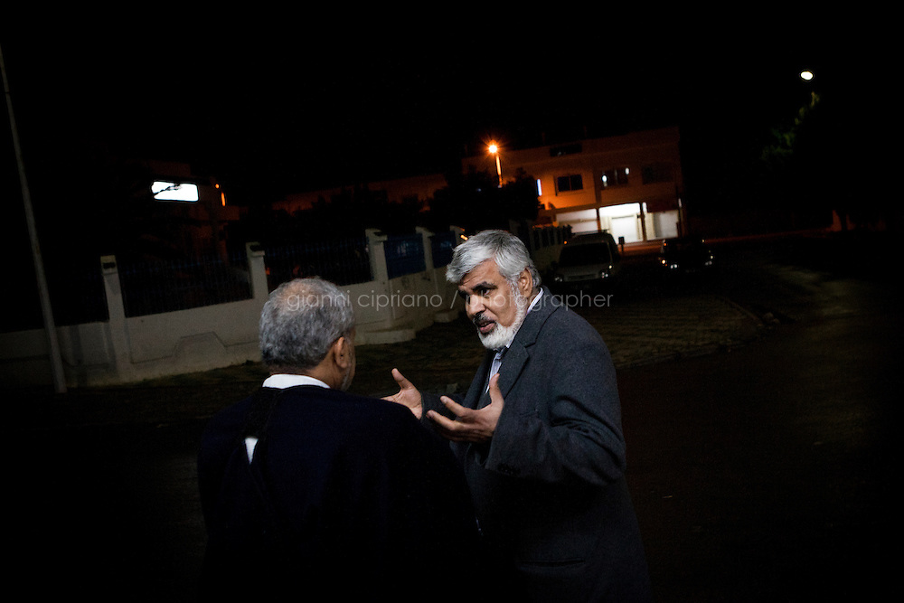 Kairouan, Tunisia - 17 December, 2011: Said Ferjani (right), 57, senior member of the political and communication bureau of the Nahda (Renaissance) party, discusses with his lifetime friend of the Negra mosque in Kairouan, Tunisia on 17 December, 2011. In the 24 October 2011 Tunisian Constituent Assembly election, the first elections since the Tunisian Revolution, the party won 40% of the vote, and 89 of the 217 assembly seats, far more than any other party. Said Ferjani started his activism in the Negra mosque of his hometown Kairouan when he was 16 years old, debating on politics, philosophy, economy and world events. In 1989 former dictator Zine El Abidine Ben Ali turned against Nahda (or Ennahda) and jailed 25,000 activists. Said Ferjani was jailed and tortured. He then flew Tunisia and moved to the UK. He came back to Tunisia after 22 years, after former dictator Ben Ali flew the country.<br /> <br /> Gianni Cipriano for The New York Times