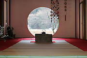 round window in a traditional Japanese tea ceremony room at the Meigetsuin Temple Garden, Kamakura Japan