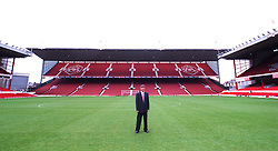 The New Arsenal Manager Arsene Wenger pictured in the middle of the pitch at Highbury