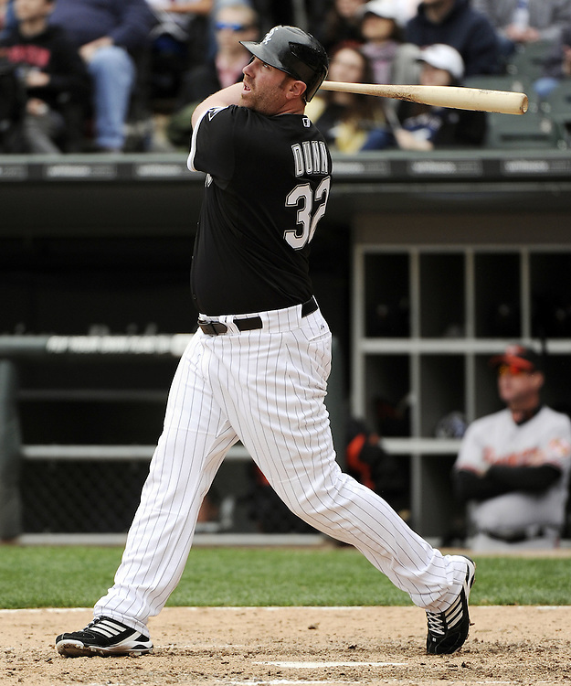 CHICAGO - MAY 01:  Adam Dunn #32 of the Chicago White Sox hits a home run in the eighth inning against the Baltimore Orioles on May 01, 2011 at U.S. Cellular Field in Chicago, Illinois.  The Orioles defeated the White Sox 6-4.  (Photo by Ron Vesely)  Subject:   Adam Dunn
