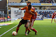 Middlesbrough defender Tomas Kalas holds up Wolverhampton Wanderers midfielder Rajiv van La Parra during the Sky Bet Championship match between Wolverhampton Wanderers and Middlesbrough at Molineux, Wolverhampton, England on 24 October 2015. Photo by Alan Franklin.