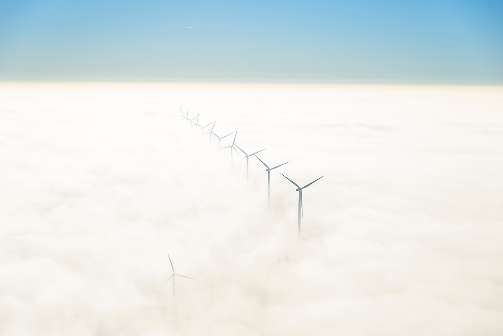 Nederland, Flevoland, Lelystad, 11-12-2013; windmolens steken boven de mist en wolken uit. Zuidelijk Fleovloand, tussen Vogelweg en Gooiseweg (ten ZO Almere)<br /> Wind turbines rise above the fog and clouds. New Polder Flevoland.<br /> luchtfoto (toeslag op standaard tarieven);<br /> aerial photo (additional fee required);<br /> copyright foto/photo Siebe Swart.