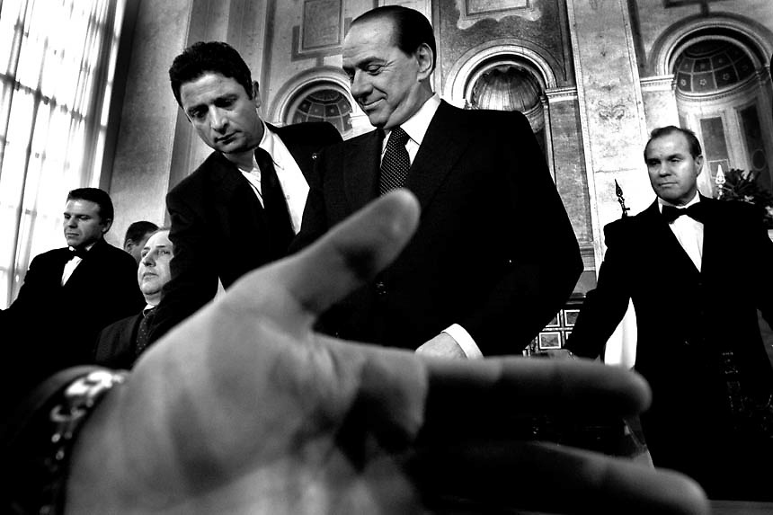 Italian Prime Minister Silvio Berlusconi attends end of year press conference at Palazzo Madama in Rome. The Italian antitrust probe established that the italian Premier violated conflict-of-interest laws after his government approved subsidies to italians to buy digital television decoders. Berlusconi declined the accuse commenting that the violation is unfounded