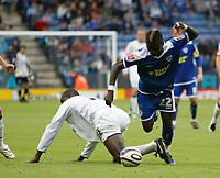 Photo: Steve Bond/Richard Lane Photography<br />Leicester City v MK Dons. Coca-Cola League One. 09/08/2008. Max Gradel (R) skips past Jude Stirling (L)