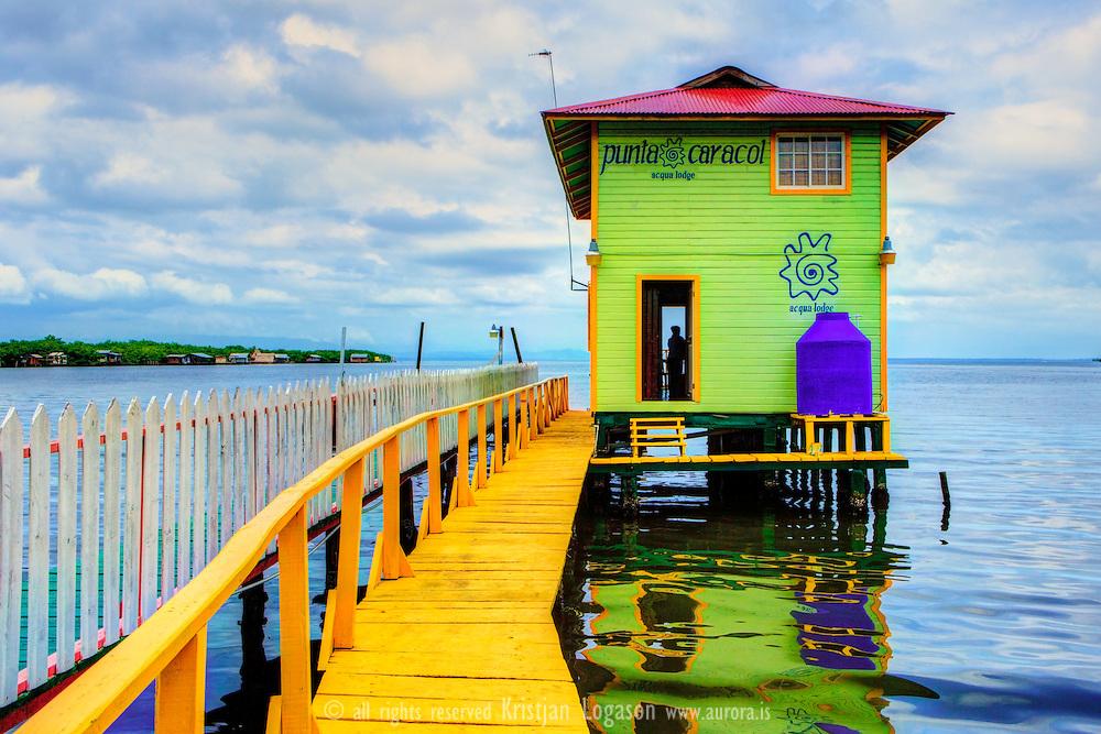 Yellow pier and green house in Punta Carol in  Bocas del Toro Panama