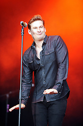 © Licensed to London News Pictures. 16/07/2015<br /> Rochester Castle Concerts,Rochester,Kent<br /> blue singing.<br /> ,Lee Ryan<br /> (Byline:Grant Falvey/LNP)