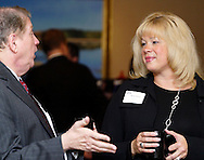Mike Kersh of LifePlan Financial Group (left) and Melissa Rabold of TW Telecom during the Dayton Area Chamber of Commerce Breakfast Briefing at the Dayton Racquet Club in downtown Dayton, Friday, January 13, 2012.