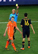 Robin Van Persie is shown a yellow card by referee Howard Webb during the 2010 FIFA World Cup South Africa  Final match between Holland and Spain at Soccer City  on 11 July, 2010 in Johannesburg, South Africa.