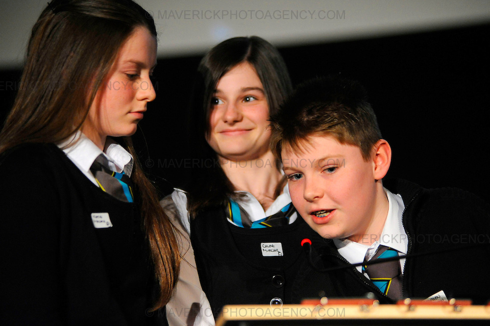 Teams compete in the Glasgow regional heats of the Times Spelling Bee contest.  Popular in the USA, the Times Spelling Bee has captured the imagination of Britain's secondary school children.  Teams from 754 schools will put their spelling to the test in 89 local heats over the next couple of months. Pictured pupils from Stewarton Academy l to r Katie MacKie, Chloe Murchie and Stephen Hamilton.