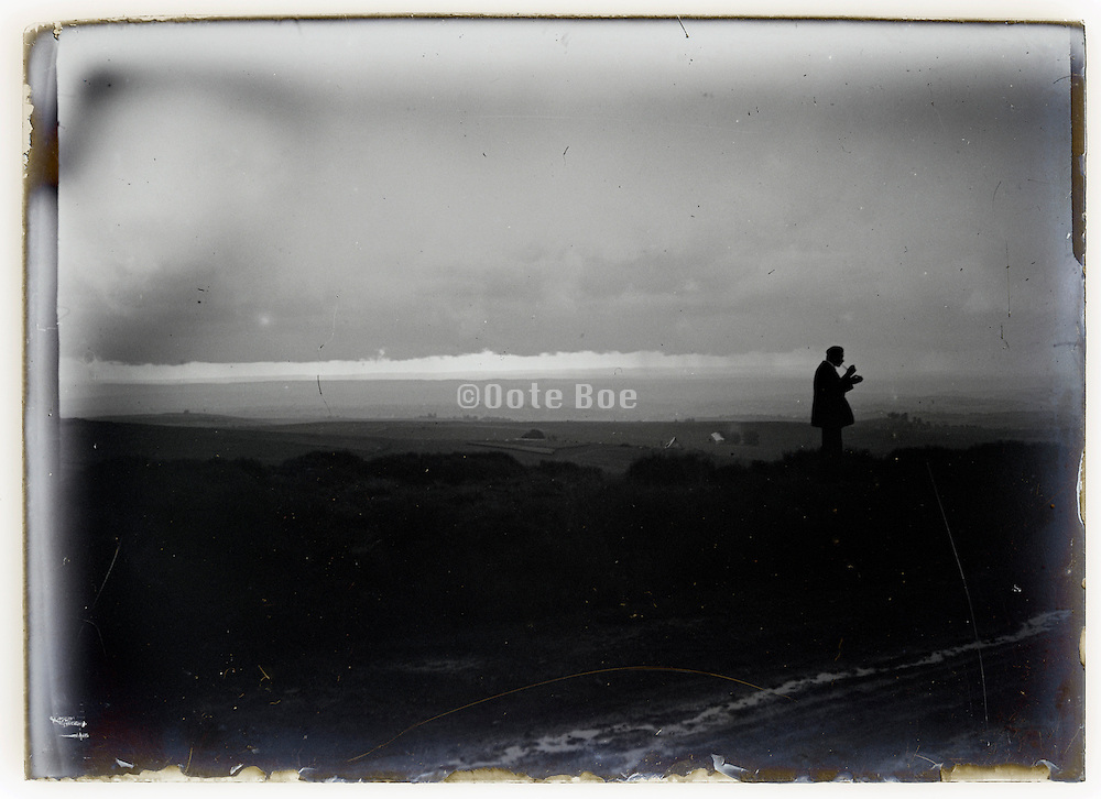 eroding glass plate with seascape and man