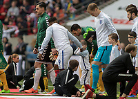 Football - 2016 / 2017 World Cup Qualifier - UEFA Group F: England vs. Lithuania<br /> <br /> Bradley Lowerey covers his ears from the noise as he and Jermain Defoe of England lead the teams onto the pitch  at Wembley.<br /> <br /> COLORSPORT/DANIEL BEARHAM
