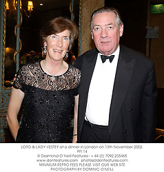 LORD & LADY VESTEY at a dinner in London on 13th November 2002.<br />