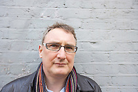 Close-up of mature man wearing glasses looking away