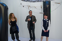 Yvonne Wilhelm (L) and Christian Hubler (C) with a Chinese museum guard in the middle of their work Naked Bandit by Knowbotic Research. KR is Christian Hubler, Alexander Tuchacek and Yvonne Wilhelm. Synthetic Times exhibition at NAMOC, Beijing, China.Synthetic Times exhibition at NAMOC, Beijing, China.