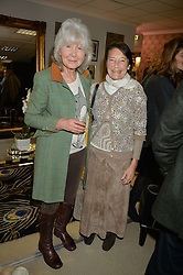 Left to right, JILLY COOPER and VISCOUNTESS MARCHWOOD at the 2015 Hennessy Gold Cup held at Newbury Racecourse, Berkshire on 28th November 2015.