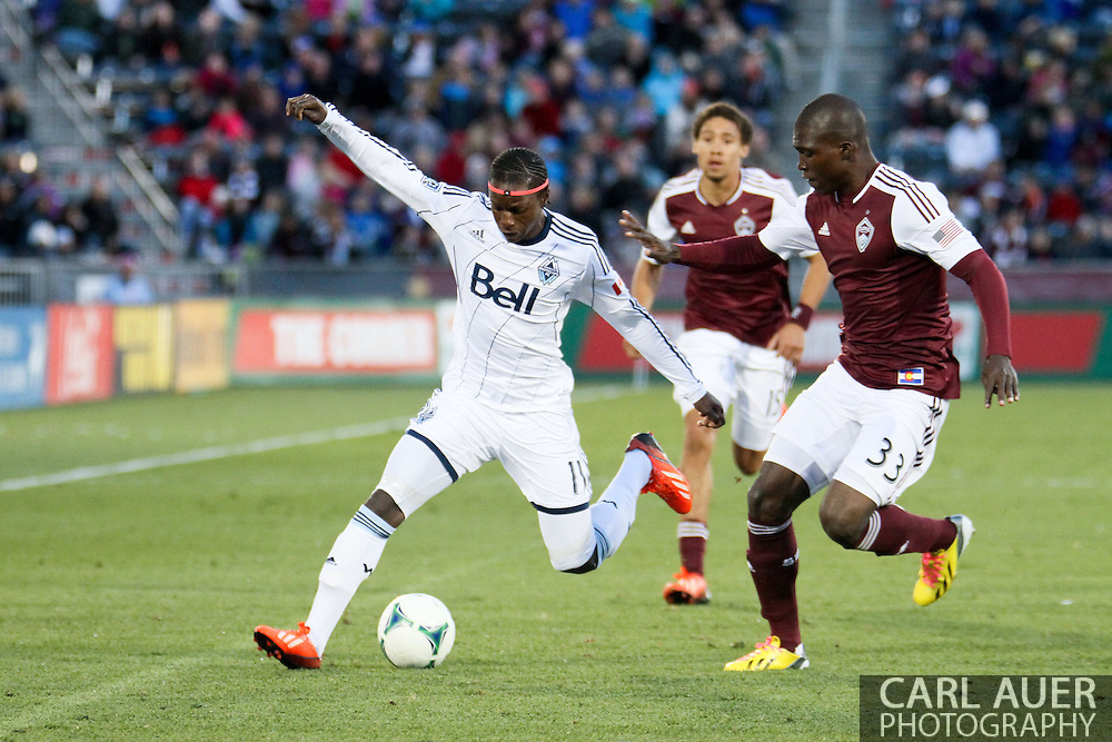 October 19th, 2013:  Vancouver Whitecaps FC forward Darren Mattocks (11) attempts to get the ball past Colorado Rapids defender German Mera (33) in second half action of the MLS Soccer Match between the Vancouver Whitecaps FC and the Colorado Rapids at Dick's Sporting Goods Park in Commerce City, Colorado