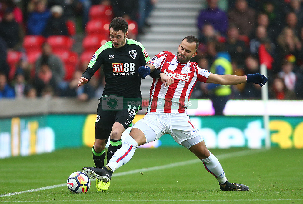 AFC Bournemouth's Adam Smith (left) and Stoke City's Jese battle for the ball during the Premier League match at the bet365 Stadium, Stoke-on-Trent.