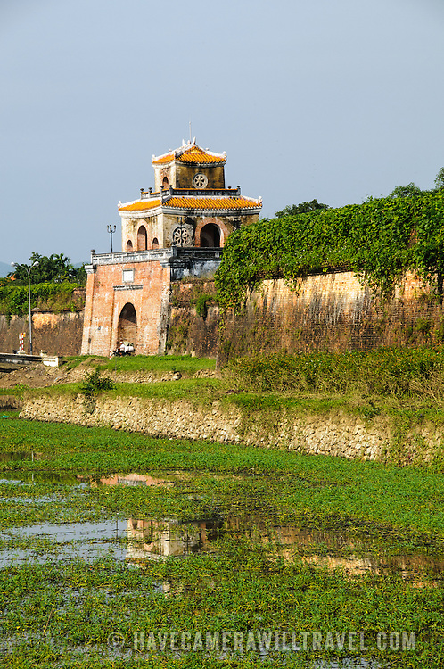 Reeds growing in the moat around the Imperial City in Hue, Vietnam. A self-enclosed and fortified palace, the complex includes the Purple Forbidden City, which was the inner sanctum of the imperial household, as well as temples, courtyards, gardens, and other buildings. Much of the Imperial City was damaged or destroyed during the Vietnam War. It is now designated as a UNESCO World Heritage site.