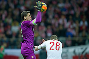 Poland's goalkeeper Wojciech Szczesny controls the ball during international friendly soccer match between Poland and Scotland at National Stadium in Warsaw on March 5, 2014.<br /> <br /> Poland, Warsaw, March 5, 2014<br /> <br /> Picture also available in RAW (NEF) or TIFF format on special request.<br /> <br /> For editorial use only. Any commercial or promotional use requires permission.<br /> <br /> Mandatory credit:<br /> Photo by &copy; Adam Nurkiewicz / Mediasport