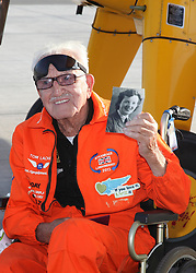 © Licensed to London News Pictures. 11/10/2014. Gibraltar, UK. Tom Lackey shows a picture of his wife after his flight around Gibraltar's Rock at Gibraltar international airport. Wheelchair bound grandfather Tom Lackey, 94, the world's oldest 'wing-walker', stands on a two-seater plane during his flight around Gibraltar's Rock on October 11, 2014. He set a world record by becoming the first person to wingwalk from Land's End to the Isles of Scilly earlier in the year. Photo credit : Anselmo Torres/LNP