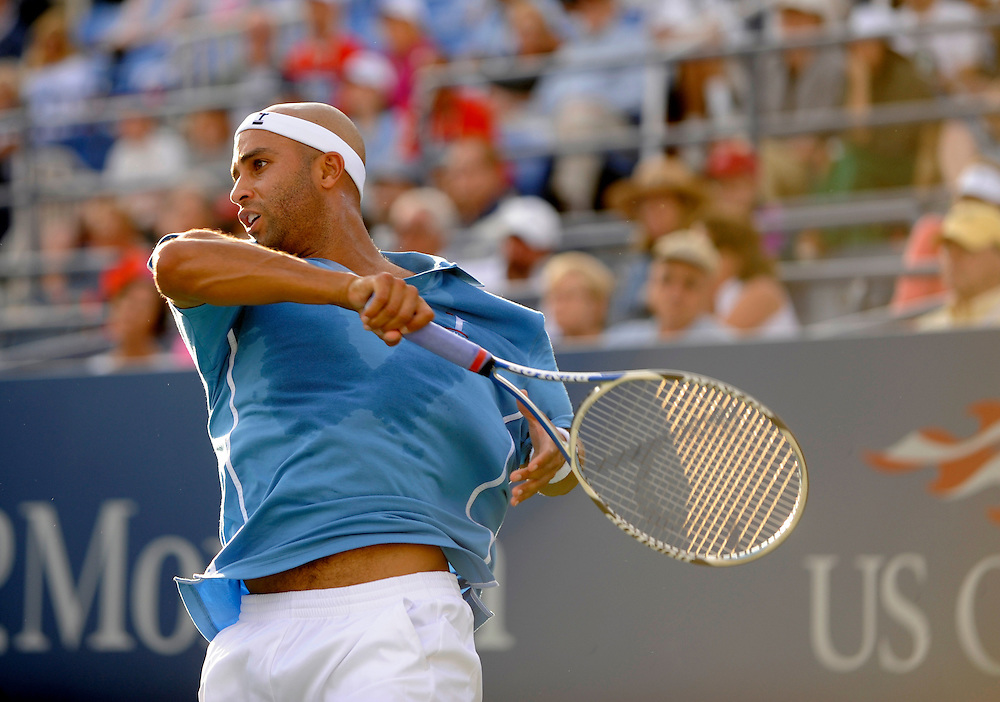 NEW YORK - AUGUST 31: James Blake returns a ball from Ruben Ramirez Hidalgo during day one of the 2009 U.S. Open at the USTA Billie Jean King National Tennis Center on August 31, 2009 in Flushing neighborhood of the Queens borough of New York City. (Photo by Rob Tringali) *** Local Caption *** James Blake