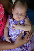 A woman holds her baby daughter during a vaccination session at the primary school in the town of Coyolito, Honduras on Wednesday April 24, 2013.