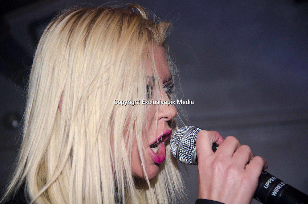 EXCLUSIVE<br /> Tara Reid parties at Drink Nightclub<br /> <br /> Model and actress Tara Reid made an appearance at Drink Nightclub located  Schaumburg on Friday, November 20, 2015.  Reid is in town for the Days of the Dead horror convention at the Chicago Schaumburg Marriot where she was taking photos with fans Nov. 20-22, 2015. The Sharknado and American Pie actress partied at Drink Nightclub until 3 a.m. entertaining friends from Ala Carte Entertainment, Chicago Prime Italian and fans for her belated birthday celebrations along with local DJs Phil Rizzo, Amada and Apollo XO.<br /> &copy;Exclusivepix Media