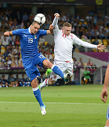 Leonardo Bonucci and Wayne Rooney  during Italy V England Quarter-finals in the Euro 2012, Sunday June 24, 2012, in Kiev, Ukraine. Photo By Imago/i-Images