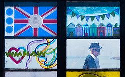 © Licensed to London News Pictures. 05/05/2018. Worthing, UK. A visitor to Worthing Pier is glimpsed through a stained glass window - in the sunshine. Record temperatures are expected this bank holiday weekend. Photo credit: Peter Macdiarmid/LNP