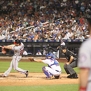 NEW YORK, NEW YORK - July 07: Daniel Murphy #20 of the Washington Nationals hits a home run off Antonio Bastardo #59 of the New York Mets as Bryce Harper #34 of the Washington Nationals waits on deck during the Washington Nationals Vs New York Mets regular season MLB game at Citi Field on July 05, 2016 in New York City. (Photo by Tim Clayton/Corbis via Getty Images)