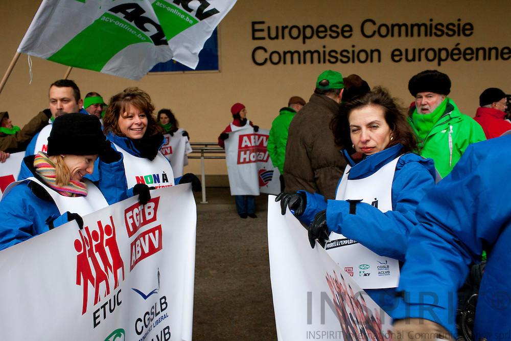 "The European trade Union Confederation (ETUC) said ""No to austerity for everyone and bonuses for a happy few"". They formed a belt around the European Commission headquarters at the Berlaymont building in Brussels Wednesday 15 December 2010, to symbolise the belt-tightening of austerity. Photo Erik Luntang /INSPIRIT Photo"