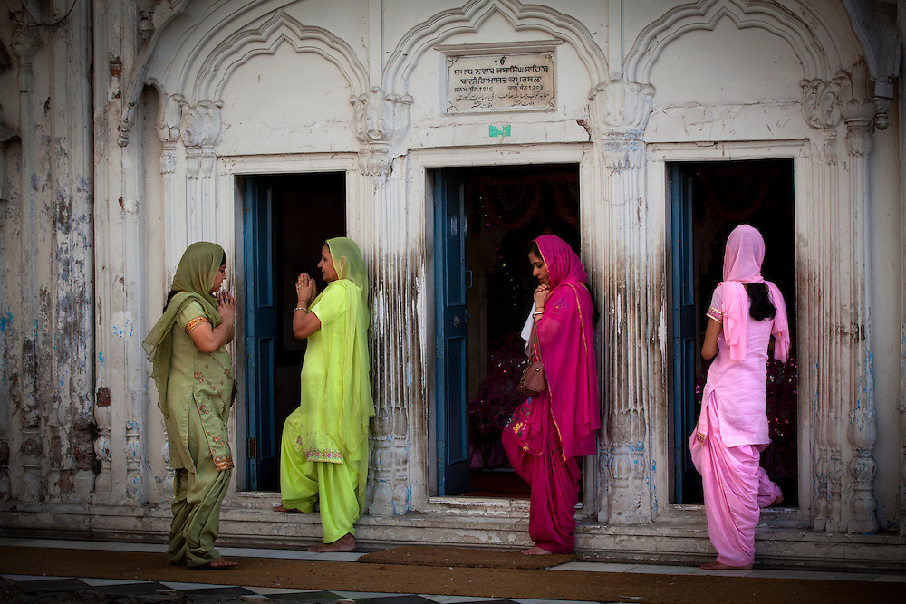 Sikh women praying at the Golden temple, Punjab,India. The variety of colors is outstanding!