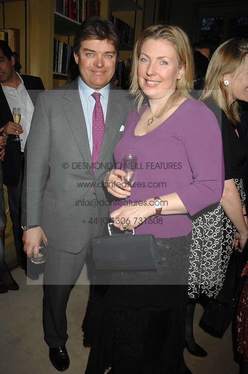 The EARL & COUNTESS OF CARNARVON at the engagement party of Vanessa Neumann and William Cash held at 16 Westbourne Terrace, London W2 on 15th April 2008.<br />